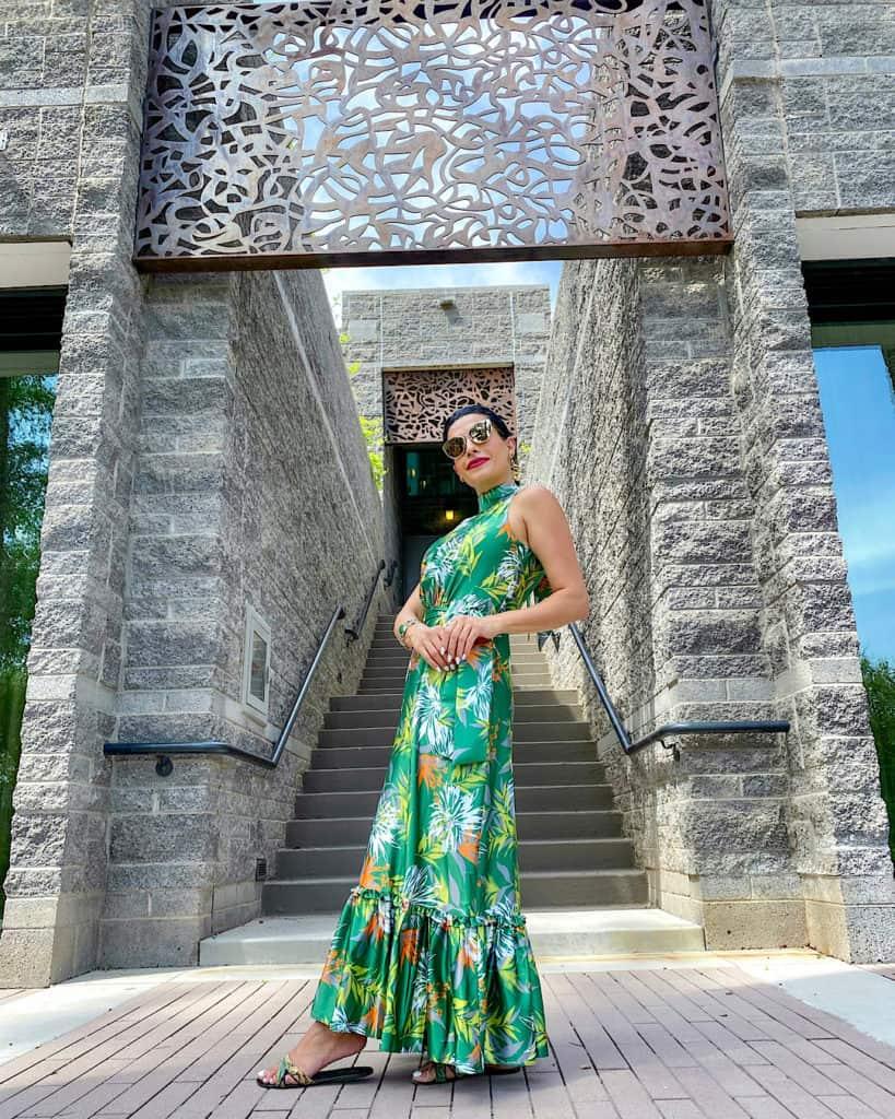 Lady in green dress standing at Avania Spa entrance at Hyatt Regency Scottsdale Arizona