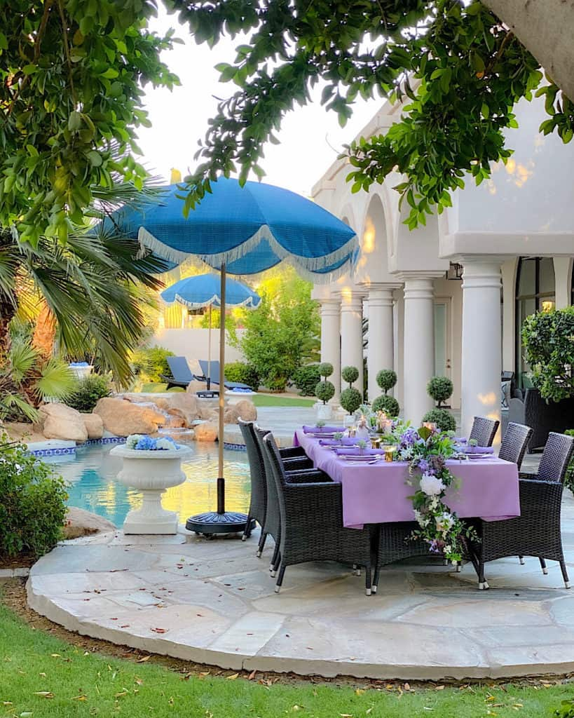 Outdoor decor trends: Purple tablescape on table by poolside