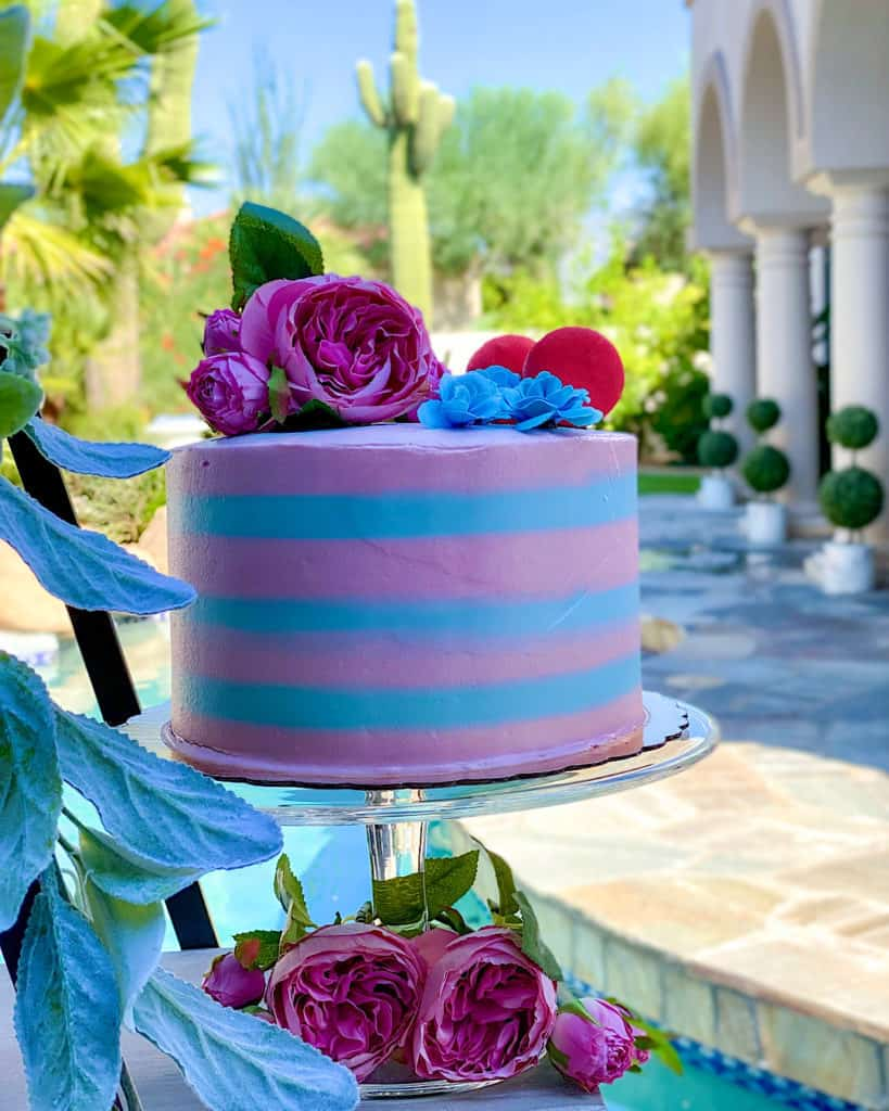 Pink and blue layer cake with pink and blue flower decorations
