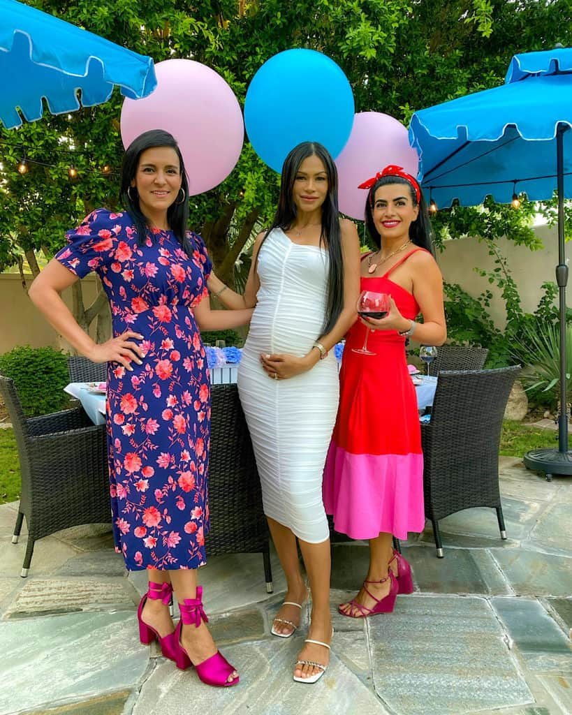 Three women at a gender reveal party