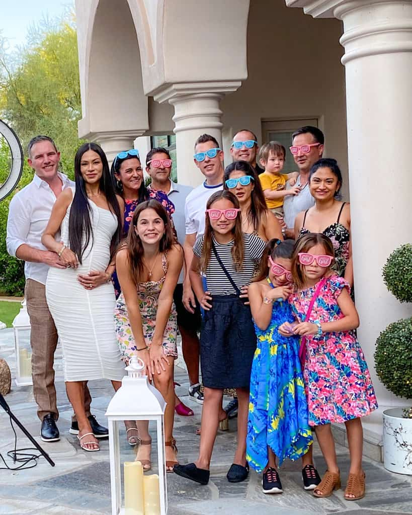 Guests wearing blue and pink fancy dress glasses at a gender reveal party