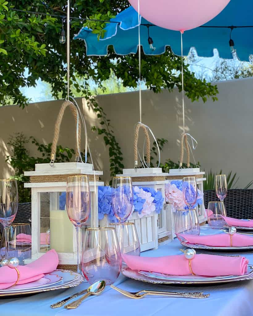 Blue and pink tablescape at a gender reveal party